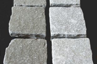 Grey Limestone Tumbled Cobbles (wet On Left, Dry On Right)