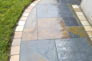 Olde English Slate Paving With Sandstone Cobble Border