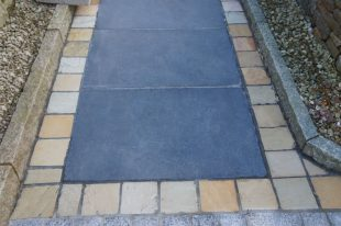 Antique Black Limestone With Tinted Mint Cobble Border