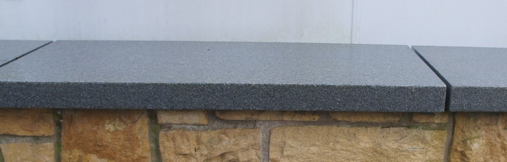 Blue granite wall coping wet
