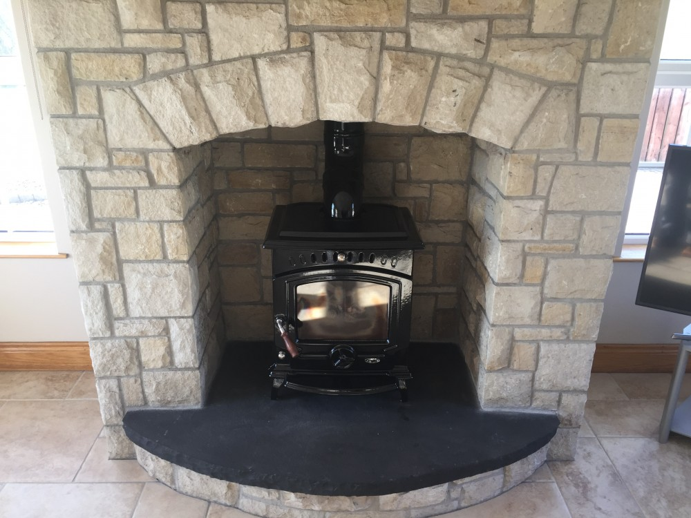 Curved free standing arch on fireplace