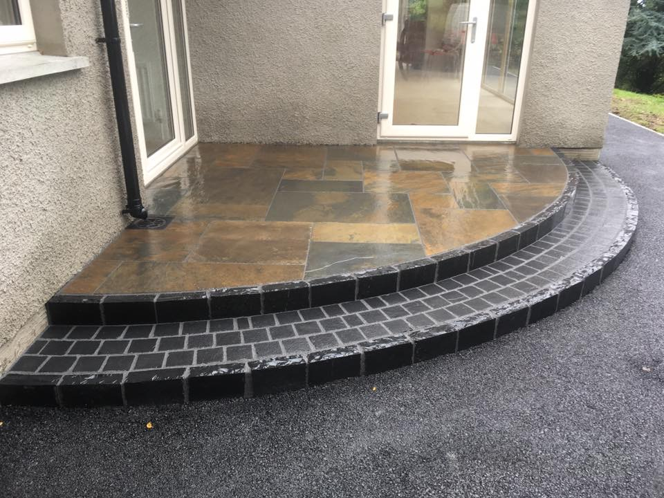 Olde English Slate Paving & Black Limestone Cobbles, with black limestone kerbs used to form risers