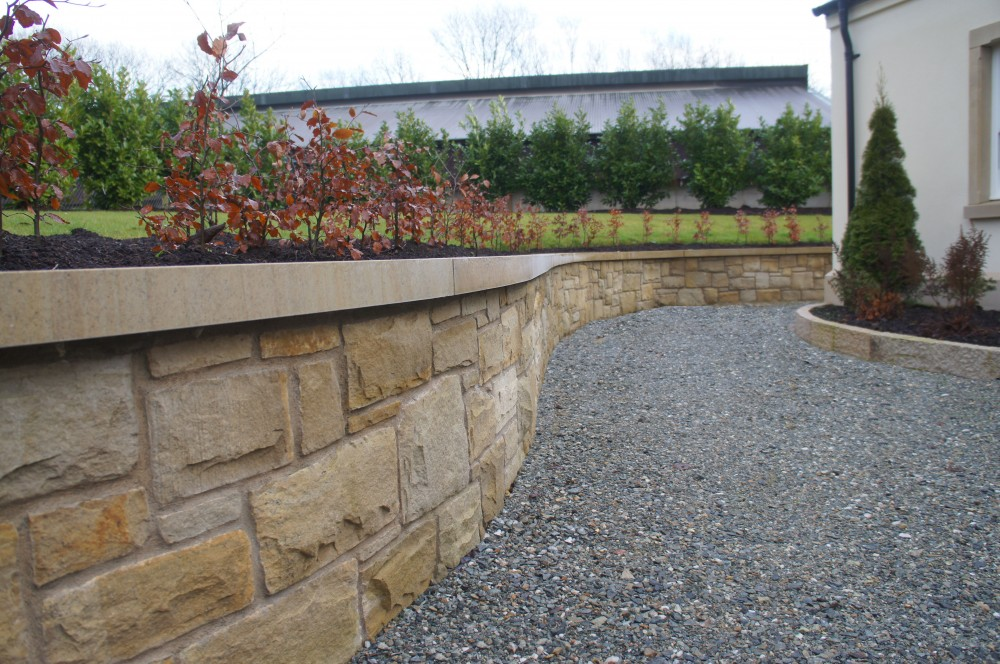 Curved Donegal Sandstone smooth wall copings