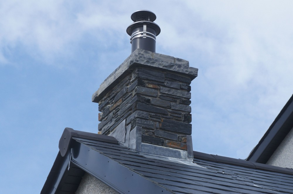 Double layered rock faced limestone chimney coping