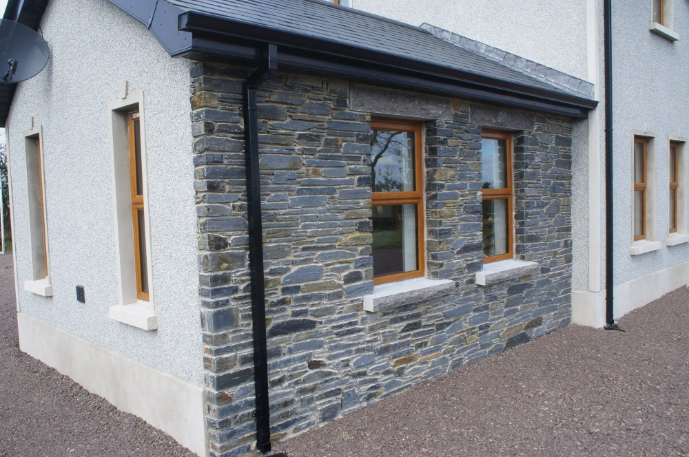 Rock faced limestone window cills