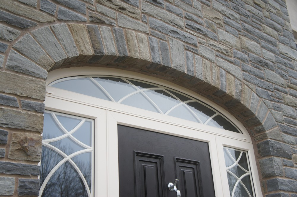 Free standing arch built over door arch