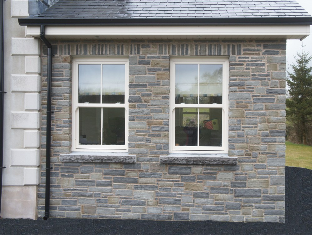 Soldiers built over a keystone lintel & rock faced limestone window cills