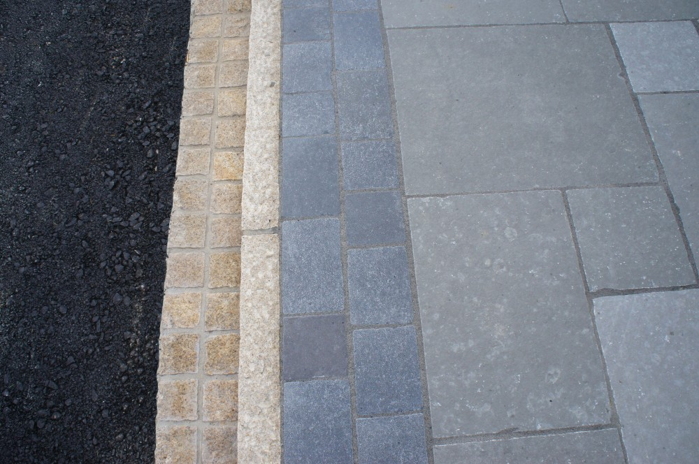 Gold Granite Cobbles Double Row And Gold Granite Kerbs Teamed With Tandur Grey Limestone With Tumbled Black Limestone Border