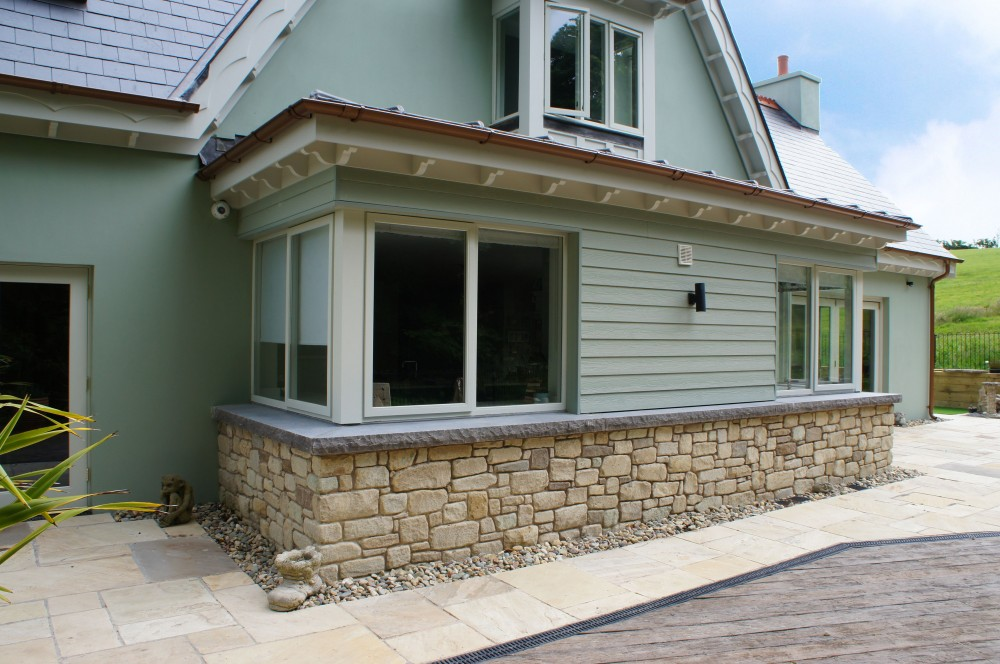 Special order extra wide rock faced limestone window cill