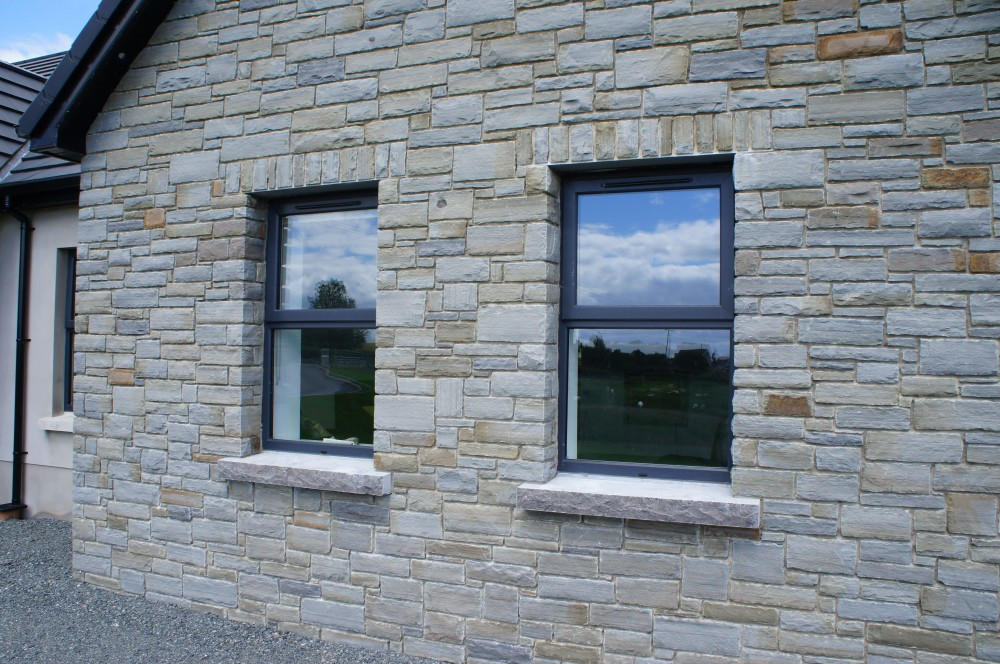 Soldiers built over keystone lintel on windows and rock faced limestone window cills