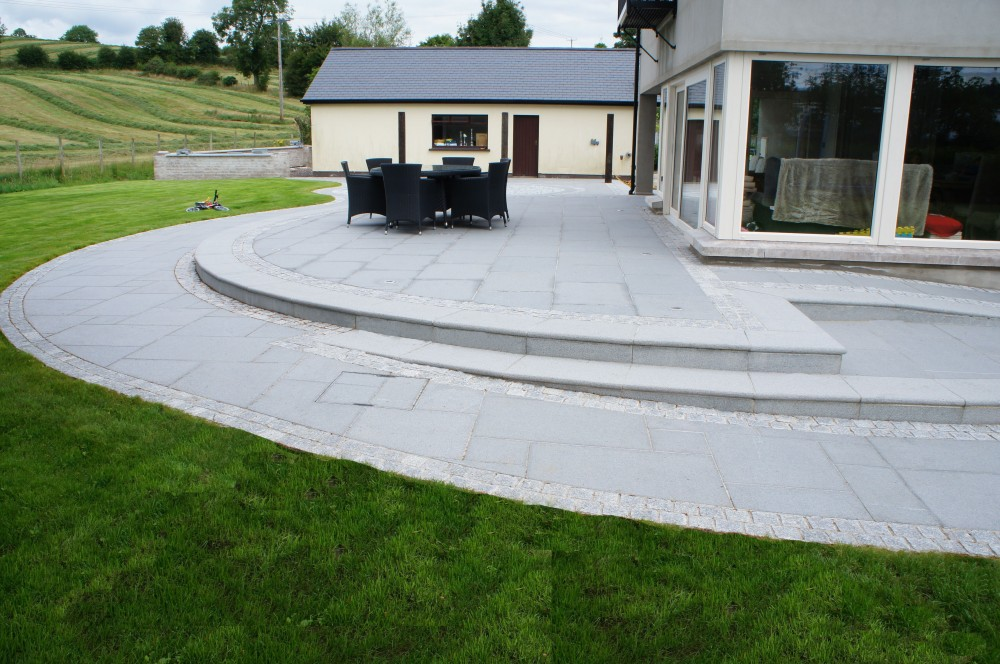 Blue Granite Paving, Steps formed using bullnosed silver granite treads and risers, Borders formed using silver granite cobbles