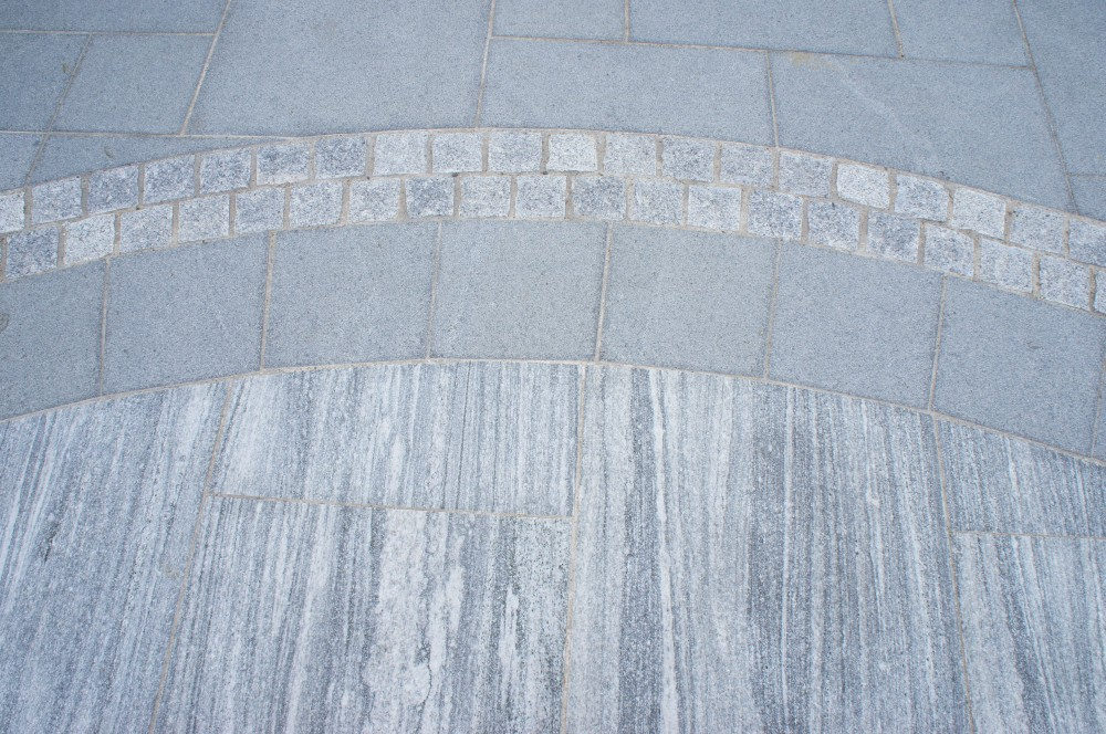 Blue granite paving with silver granite cobbles