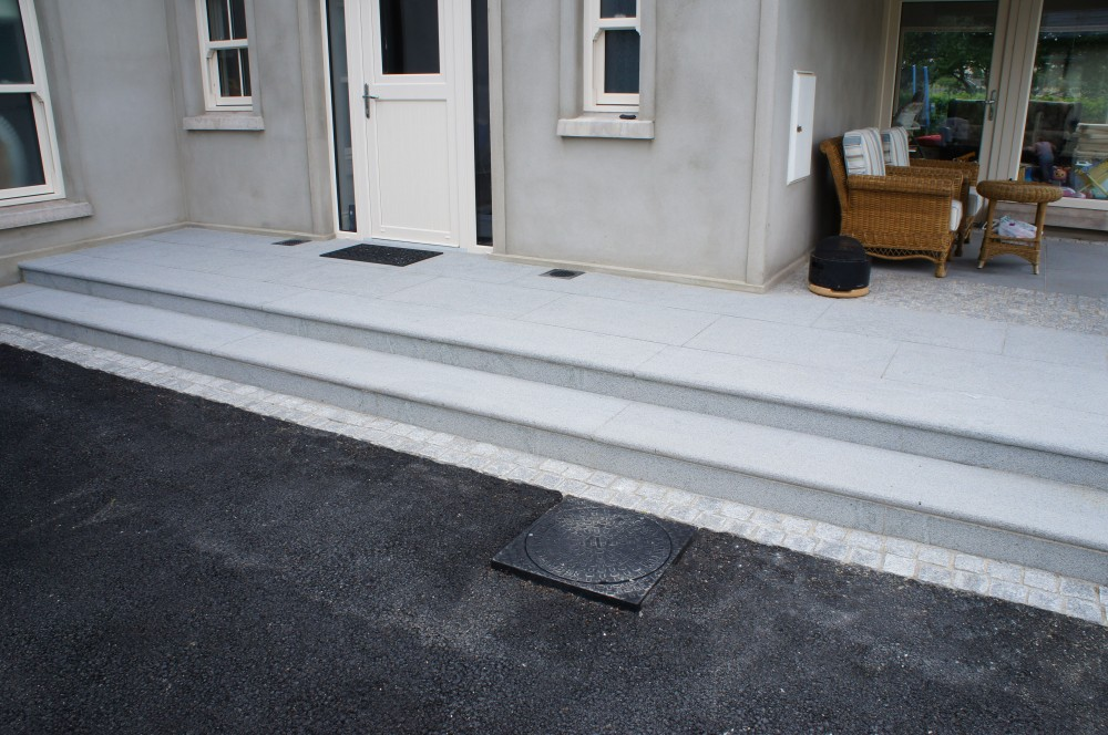 Steps formed using Bullnosed Silver Granite with a silver granite cobble border