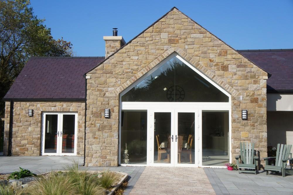 Stone built over keystone lintel on apex window