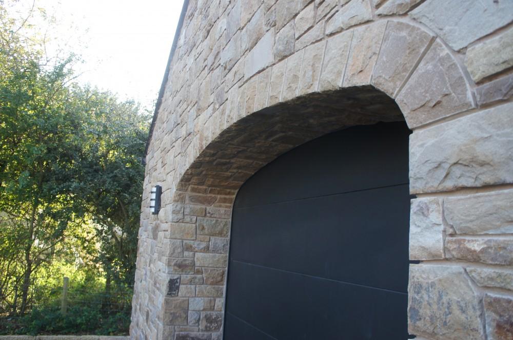 Freestanding arch built over garage opening