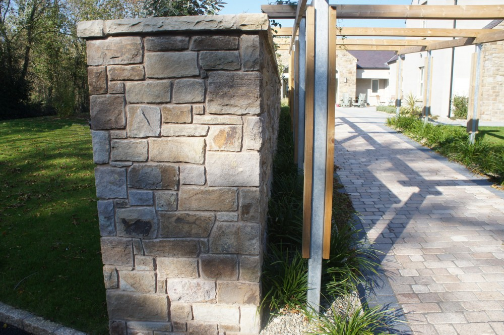 Wall built with Tipperary Sandstone and topped with tinted mint wall copings