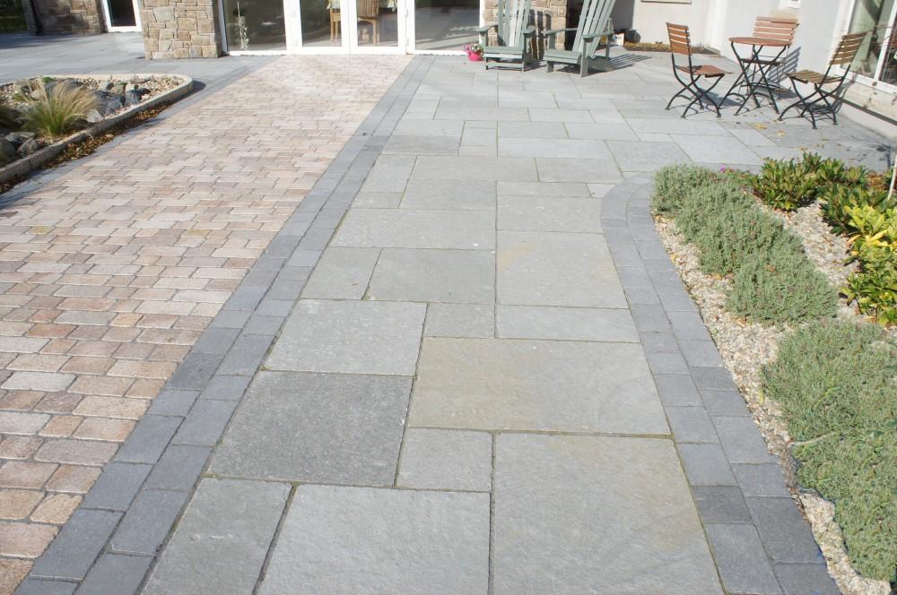 Grey limestone paving with tumbled black limestone border