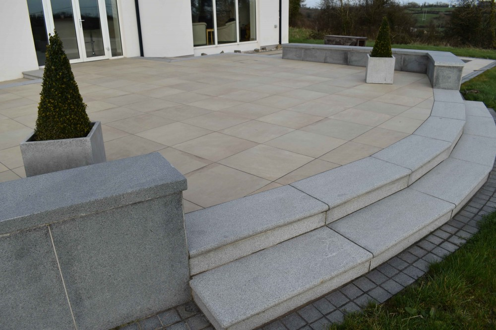 Blue granite bullnosed steps with blue granite paving on wall
